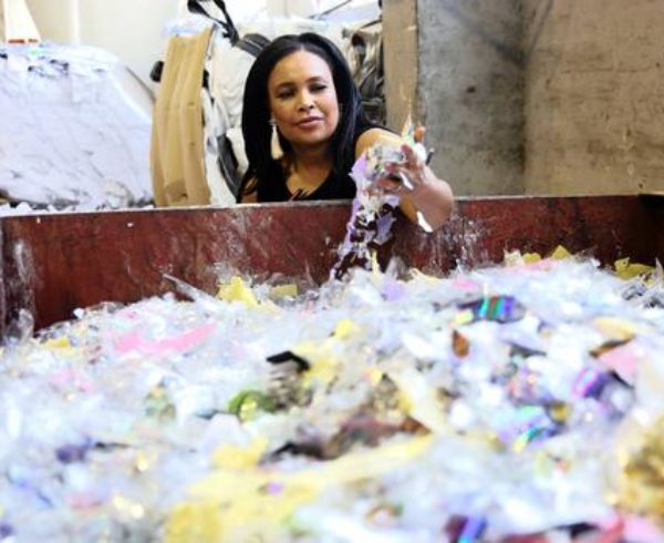 Bernadette Williams of Oricol Environmental Services inspecting some of the DVDs and CDs after they were securely destroyed